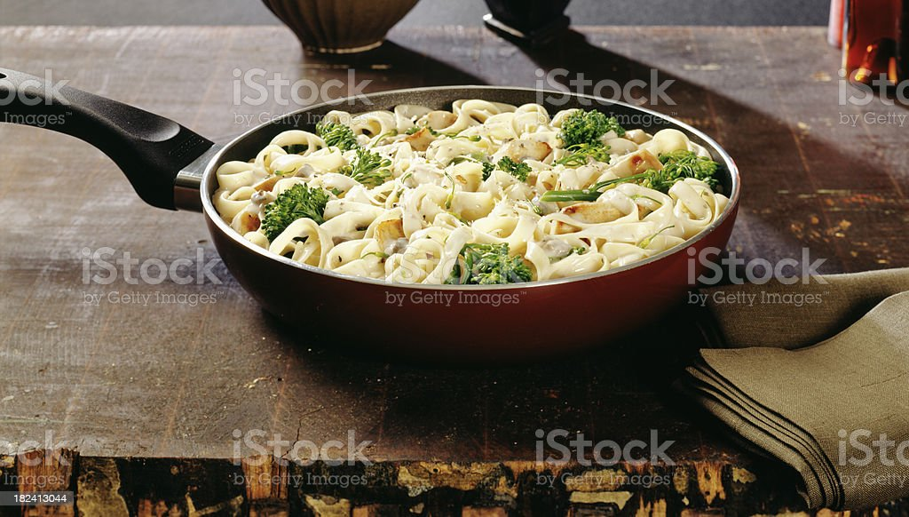 Fettuccine Alfredo Pasta with broccoli and chicken stock photo
