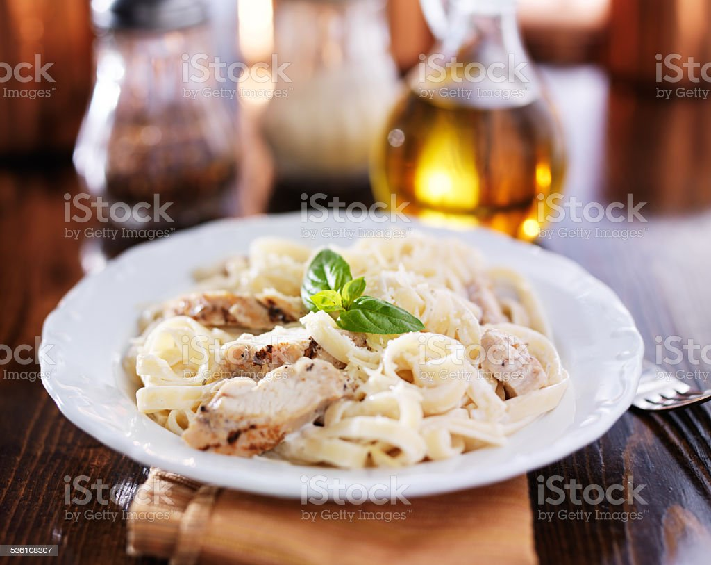 fettuccine alfredo with grilled chicken dinner stock photo