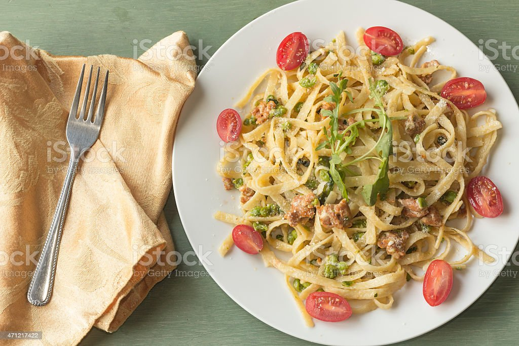 Fettuccine Alfredo with Ground Sausage stock photo