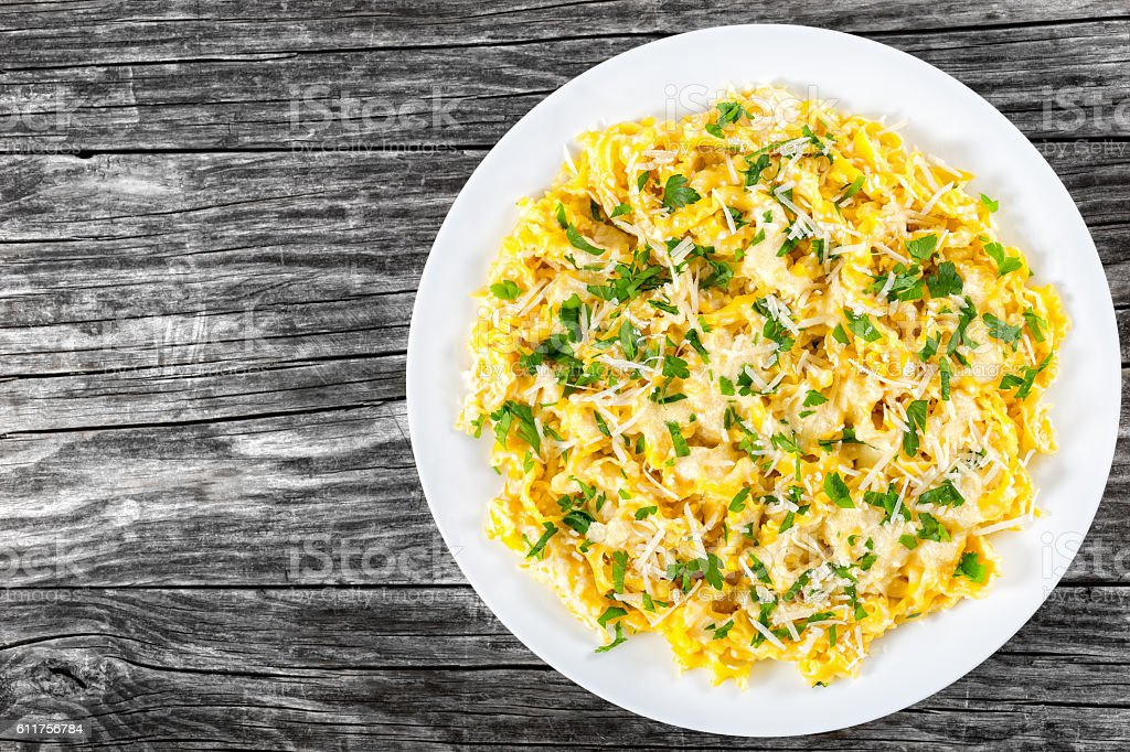 Fettuccine Alfredo with sauce of cream, butter, and grated chees stock photo