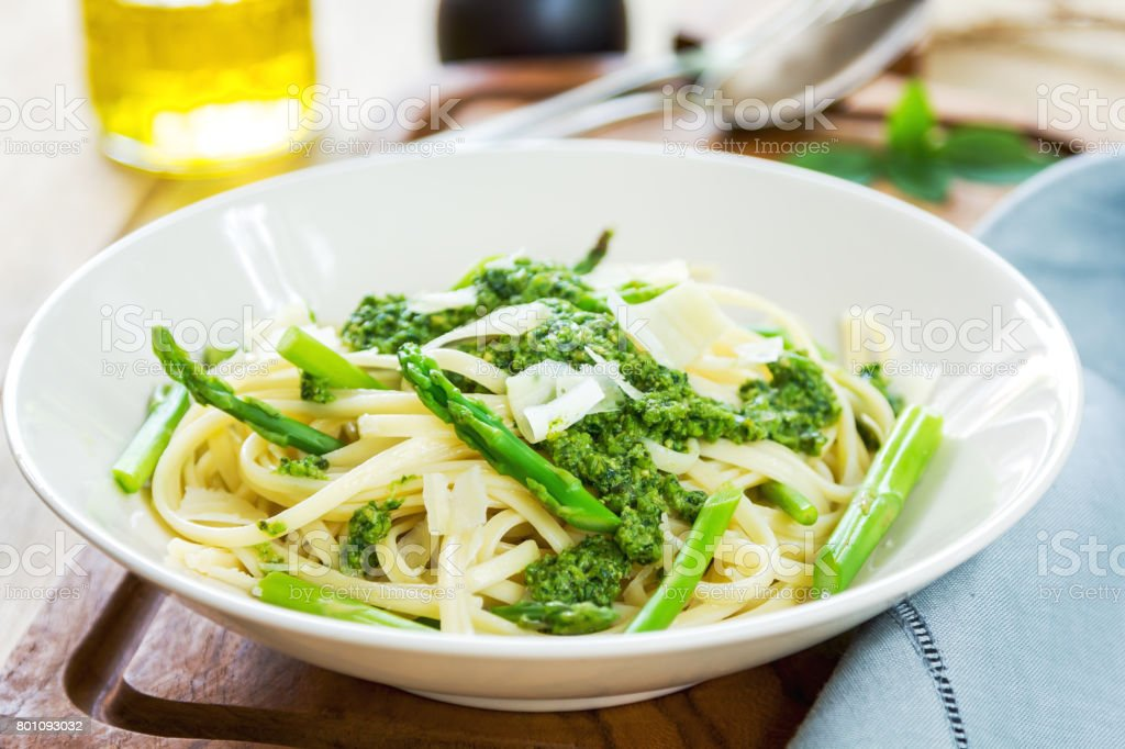 Fettuccine in Asparagus pesto with shaving parmesan on top stock photo