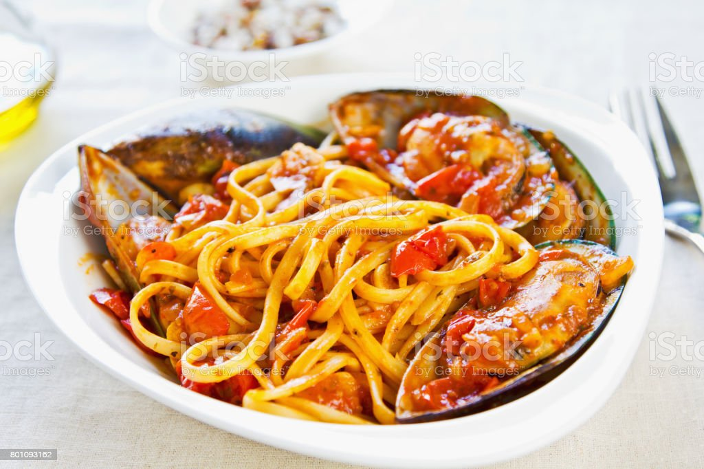 Fettuccine with Mussel in tomato sauce stock photo