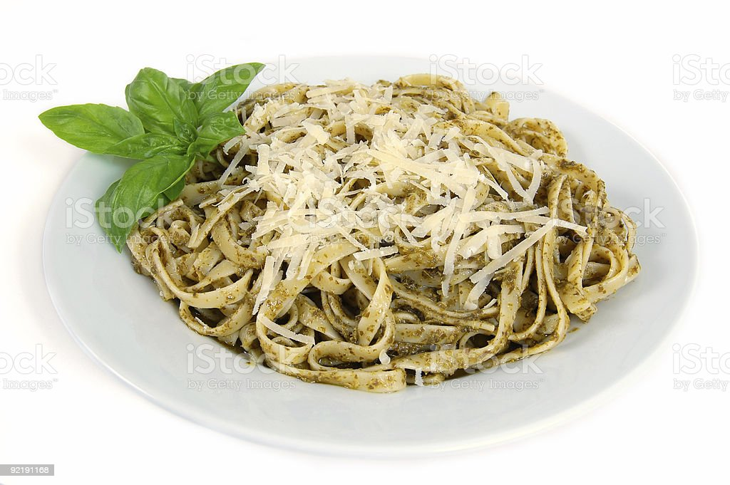 Fettuccine with pesto, grated cheese and basil stock photo