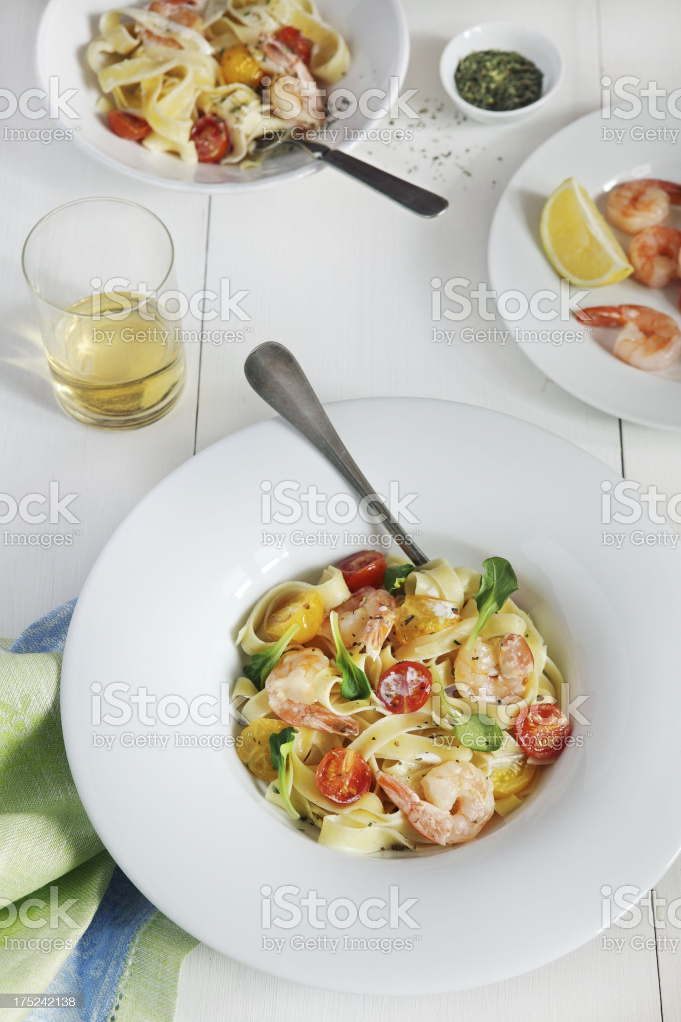 Fettuccine with shrimps, cherry tomatoes and cheese royalty-free stock photo