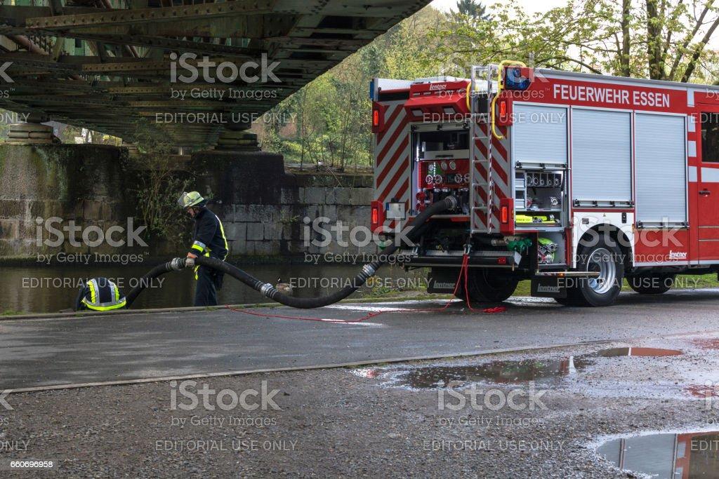 Feuerwehrmänner in Uniform beim Training. stock photo