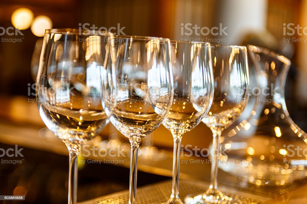few empty glasses and a decanter stock photo