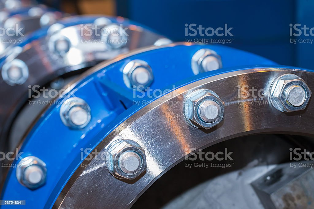 Few flanges with bolts and nuts stock photo