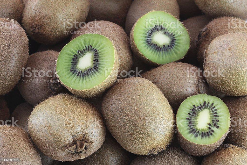 Few fresh kiwi fruits stock photo