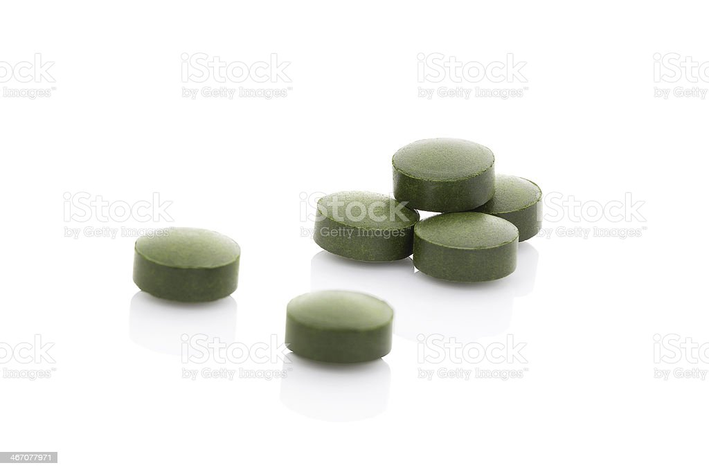 Few green pills isolaed on white background. royalty-free stock photo