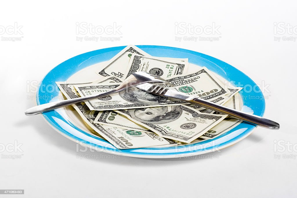 Few hundred dollars on plate royalty-free stock photo