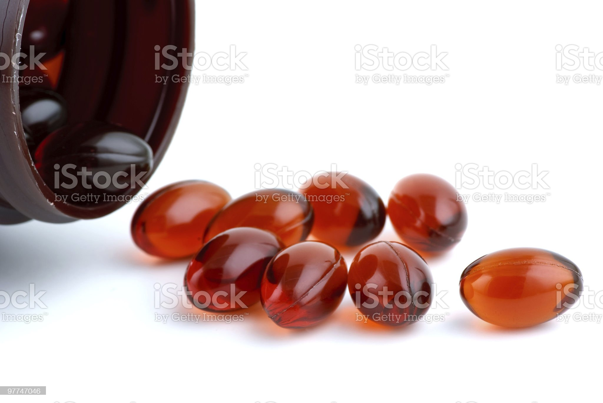 Few lecithins capsules near an open bottle royalty-free stock photo
