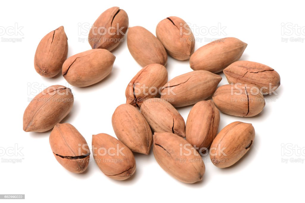 Few pecan nuts isolated on white stock photo