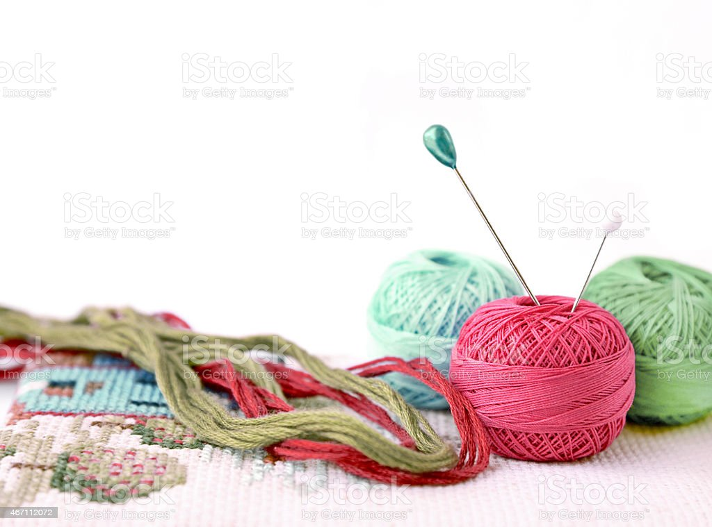 Few pins in wool ball isolated on white stock photo