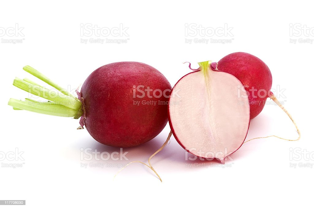 A few radishes on a white background, one cut in half stock photo