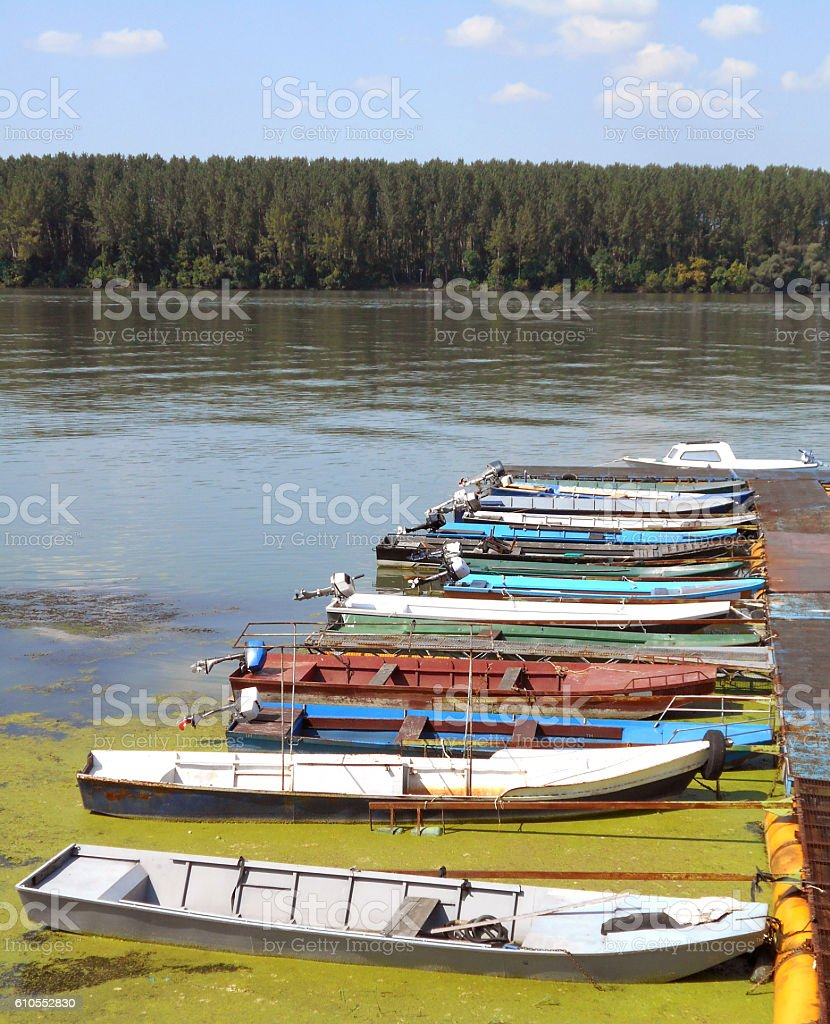 Few rowboats moored on the river mole stock photo