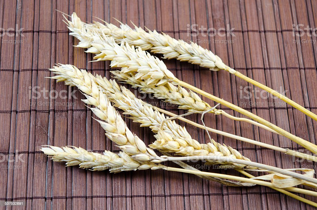 Few sticks of wheat on a table royalty-free stock photo