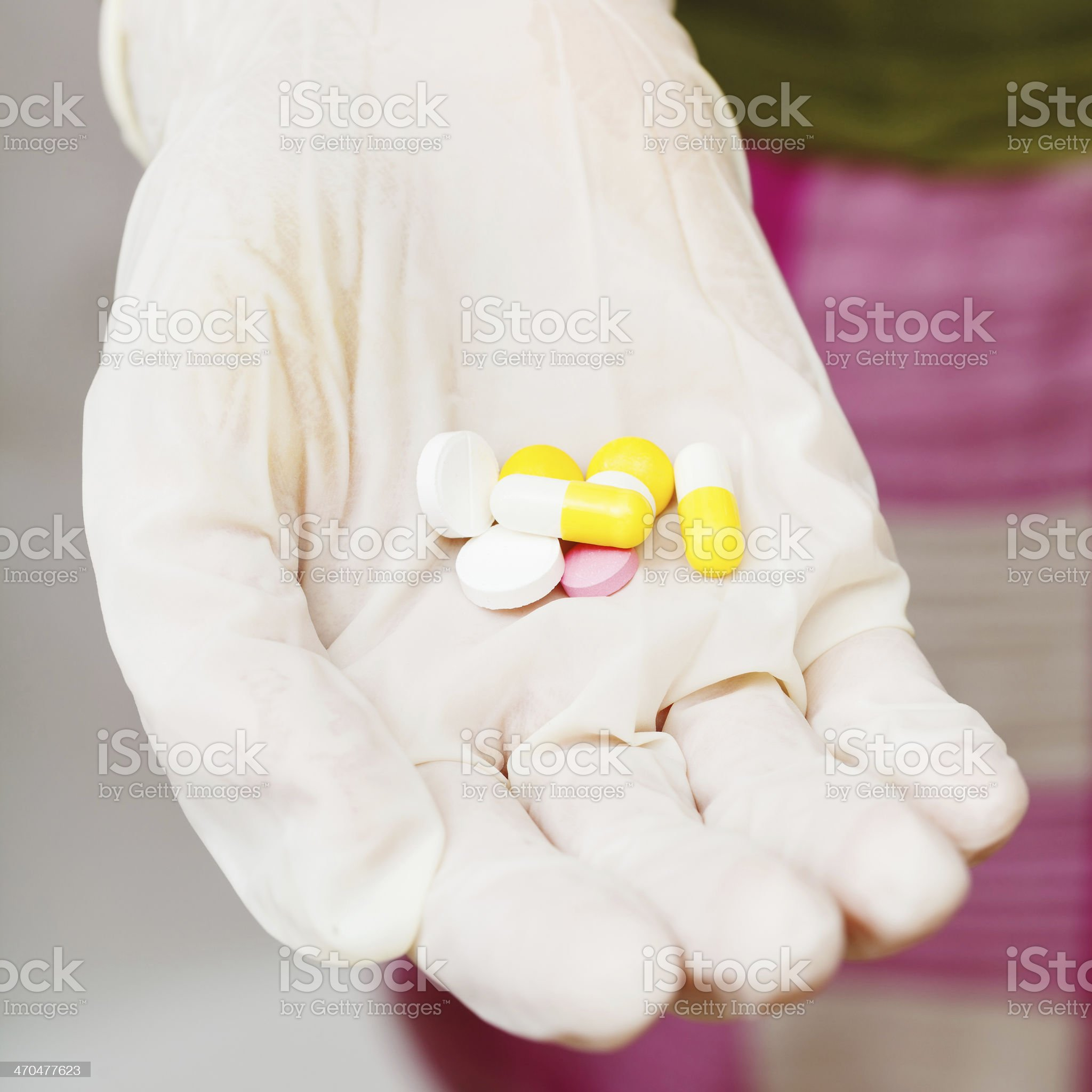 few tablets in patient gloved hand royalty-free stock photo