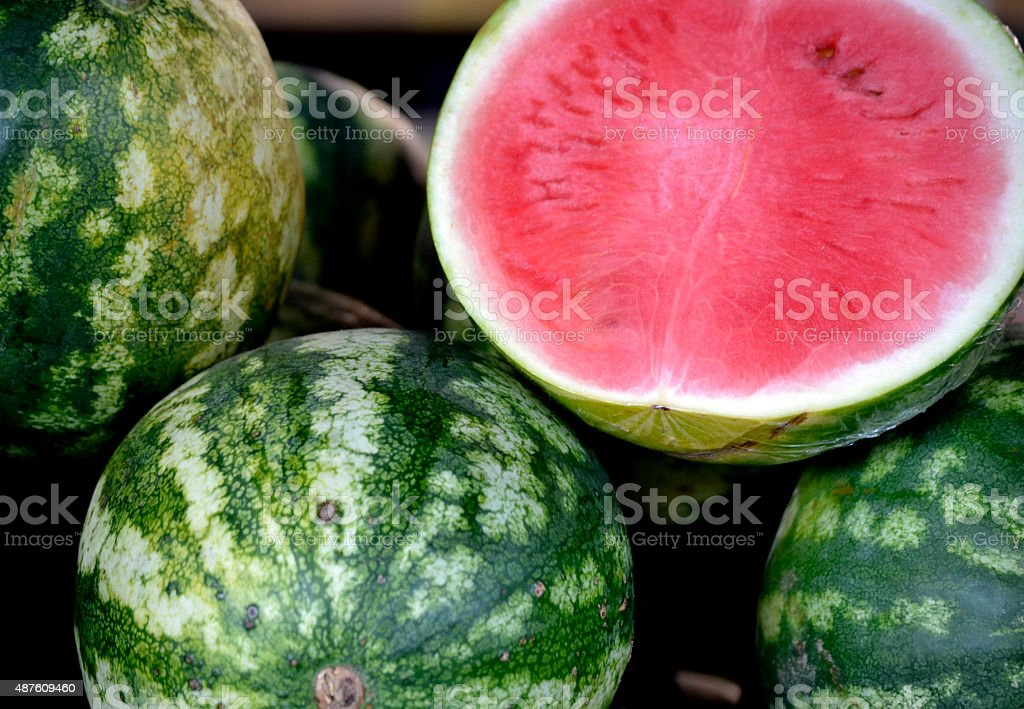 Few watermelons and one sweet half stock photo