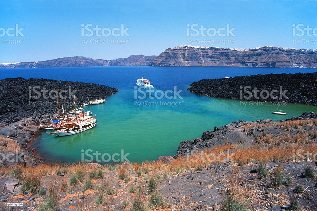 A few yachts in the harbor of Santorini royalty-free stock photo