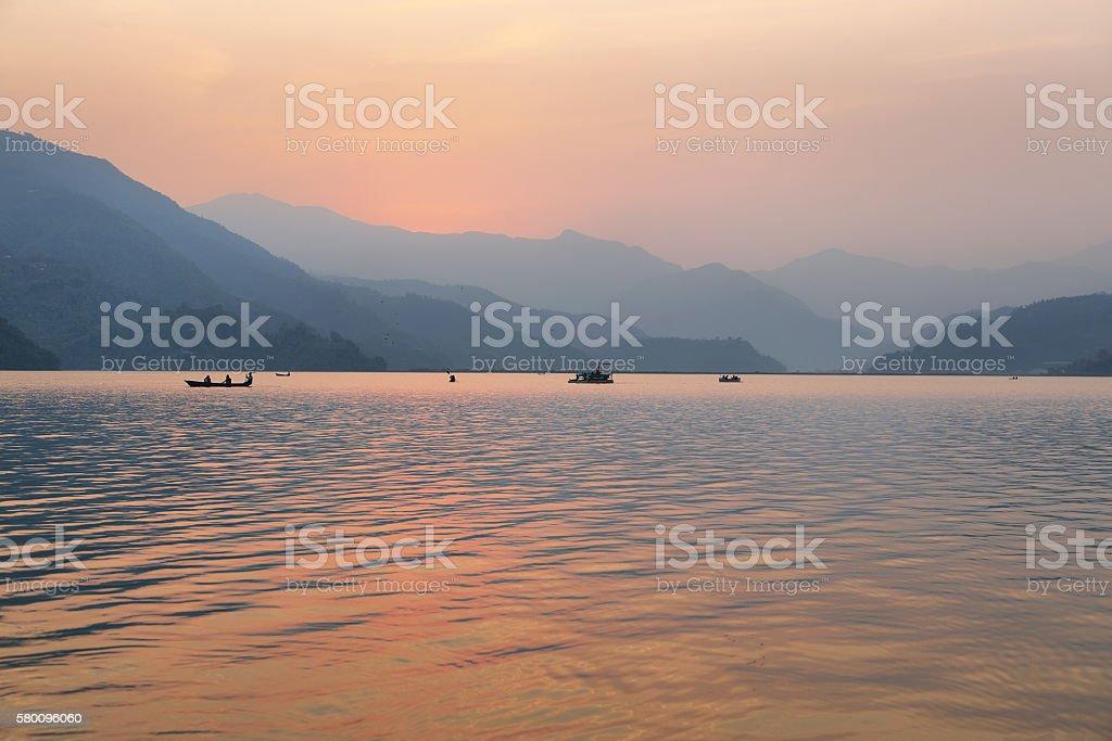 Fewa lake at sunset in Pokhara stock photo