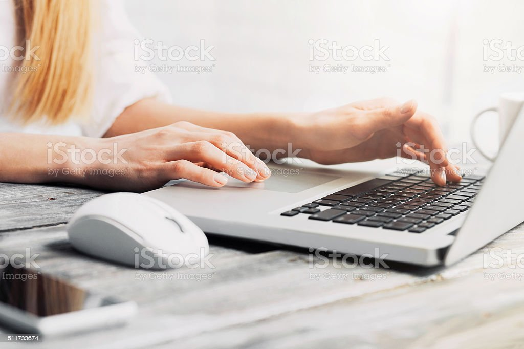 Ffemale hands on laptop keyboard stock photo