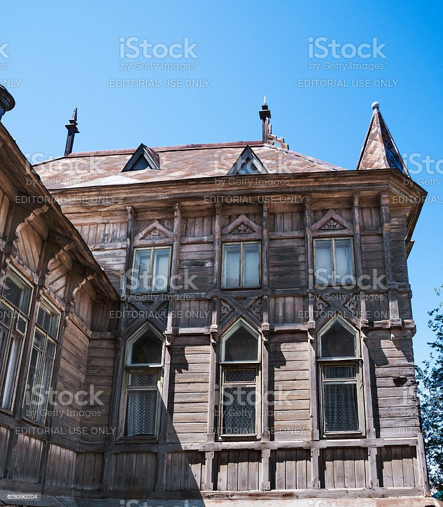 Ffragment of the old wooden building in the Gothic style stock photo