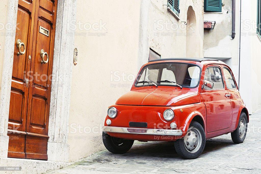 Fiat 500 Italian Car  and Classic Wooden Doors, Tuscany, Italy royalty-free stock photo