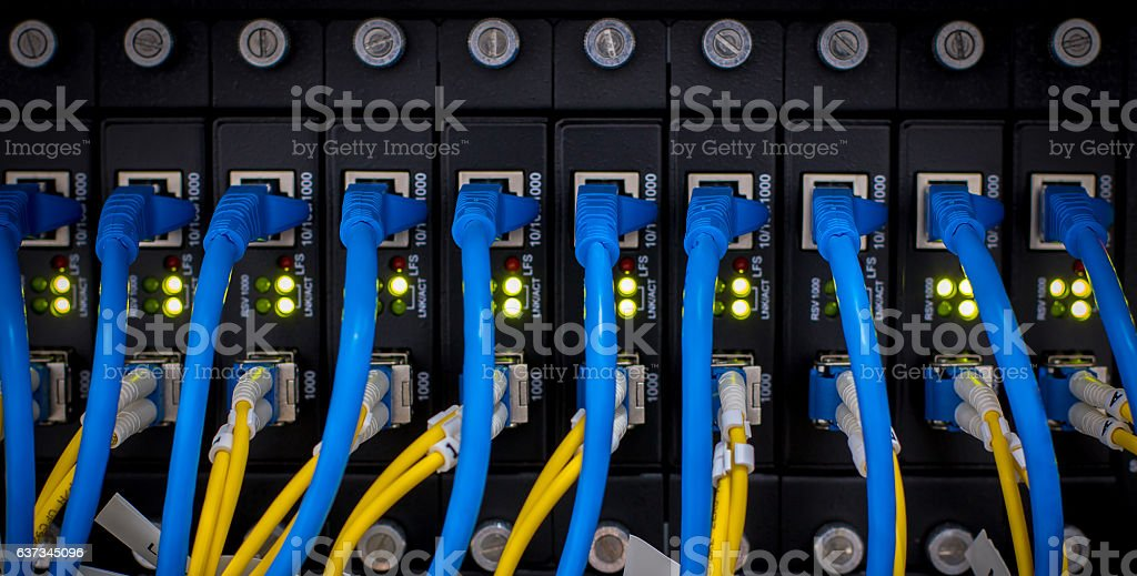 Fiber connectivity, network, server.network cables installed in the rack. stock photo