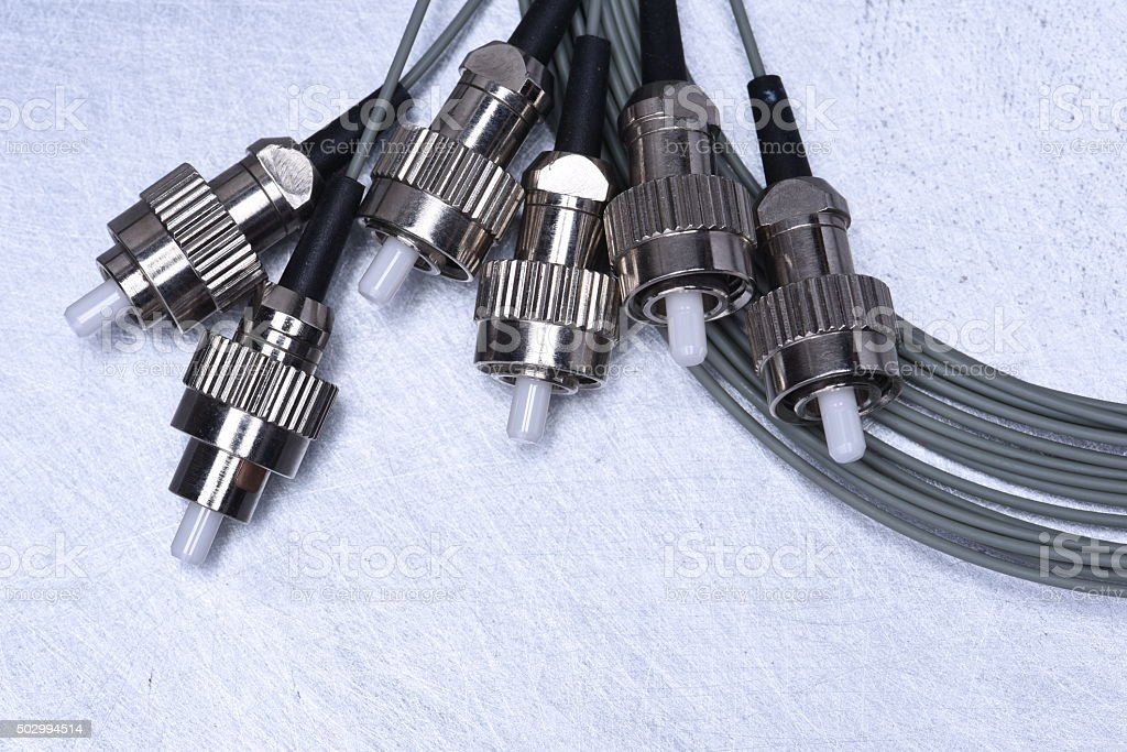 Fiber optic cable in telecommunication networks stock photo