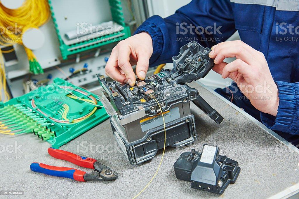 fiber optic cable splice machine in work stock photo