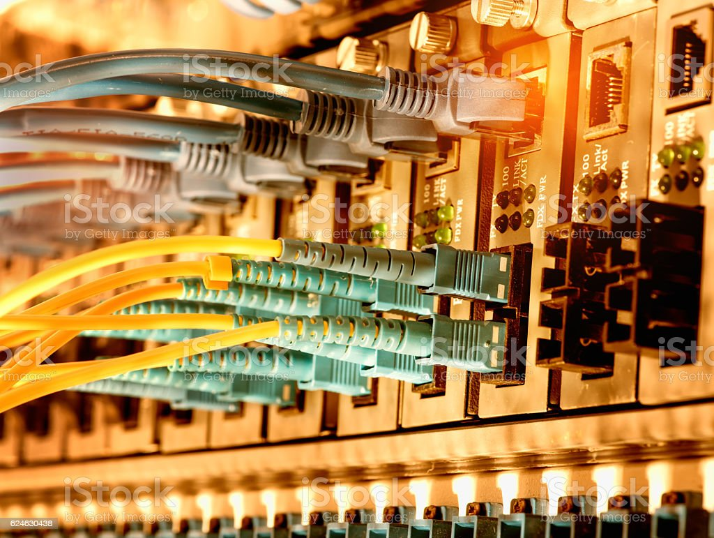 Fiber Optic cables and UTP Network cables stock photo