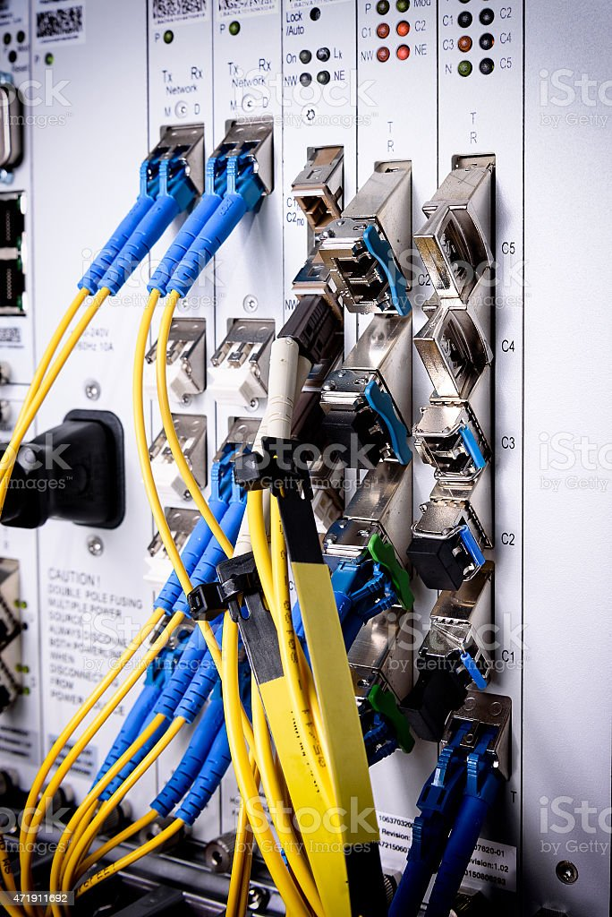 Fiber optic connecting on core network swtich stock photo