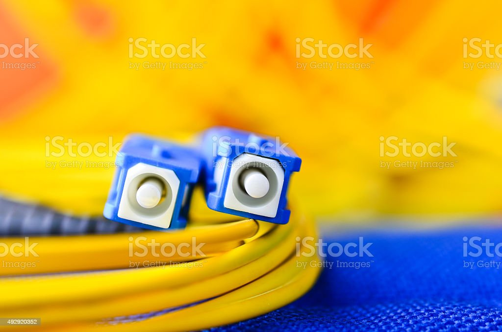 Fiber optic connectors close up on a colourful background. stock photo