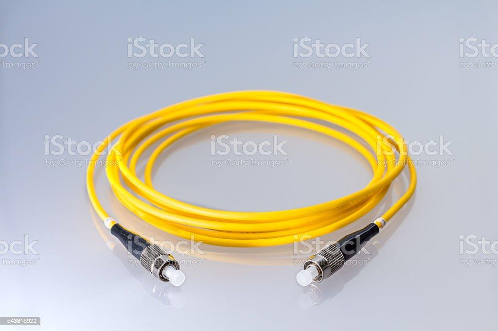 Fiber optic single mode FC jack over gray background. stock photo