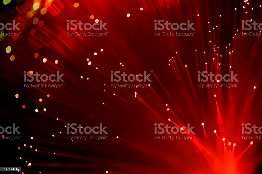 Fiber optics abstract background (red) stock photo