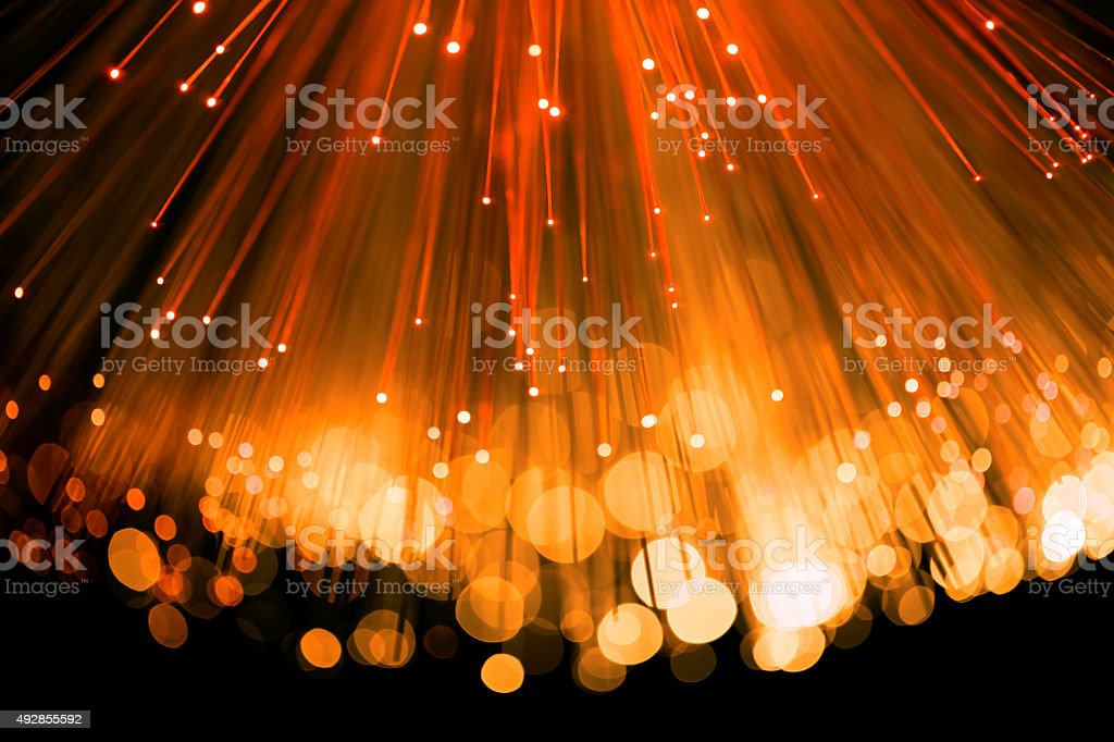 Fiber optics abstract background (orange) stock photo