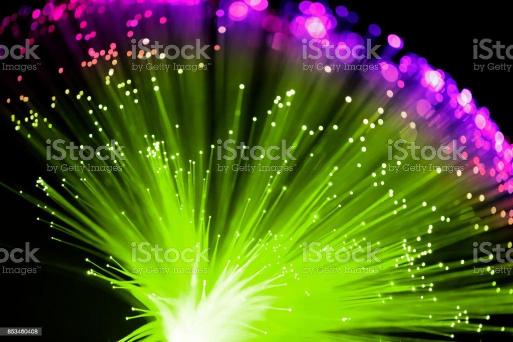 Fiber optics abstract background (green / purple) stock photo
