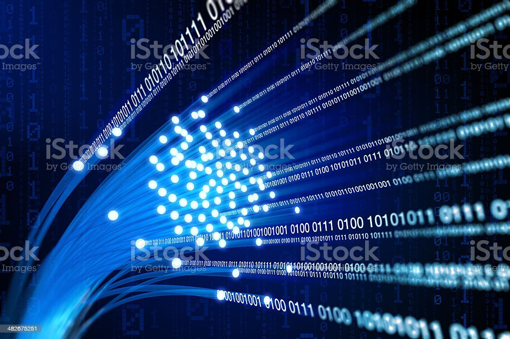 Fiber optics with streams of binary data stock photo