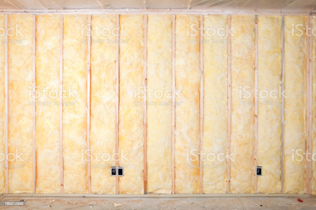 Fiberglass Batt Insulation between House Wall Studs stock photo