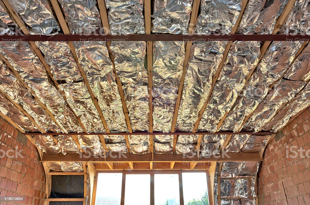 Fiberglass batt insulation between roof trusses stock photo