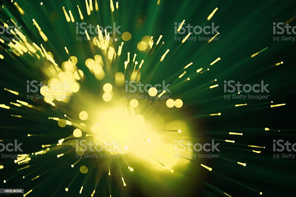 Fiberoptic data transmission appearing as purple lights and dots stock photo