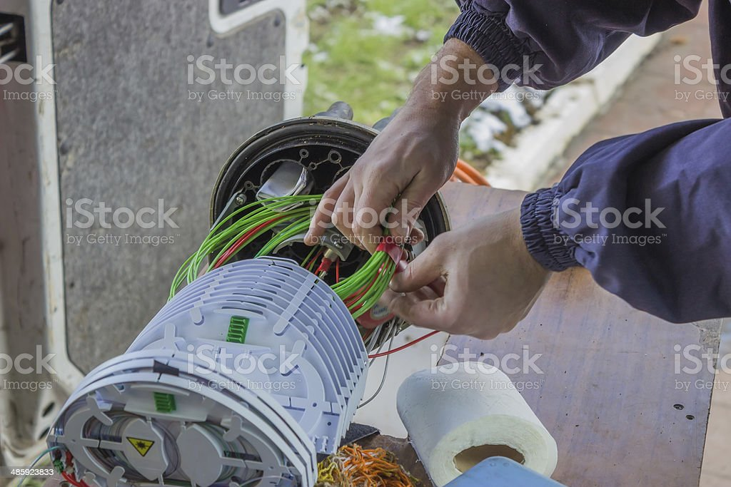 Fibre optic technician rolls of fibre-optic cables stock photo