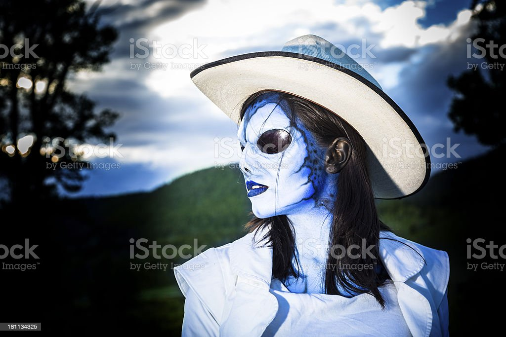 Fictional Character:  Alien cowgirl looking away. stock photo