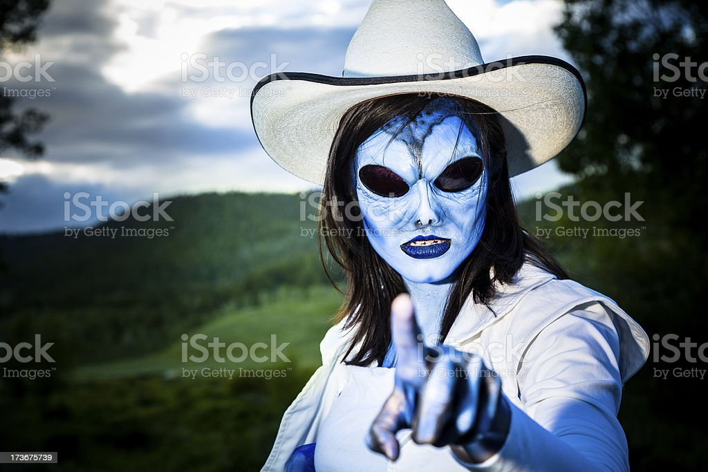 Fictional Character:  Alien cowgirl pointing at you. stock photo