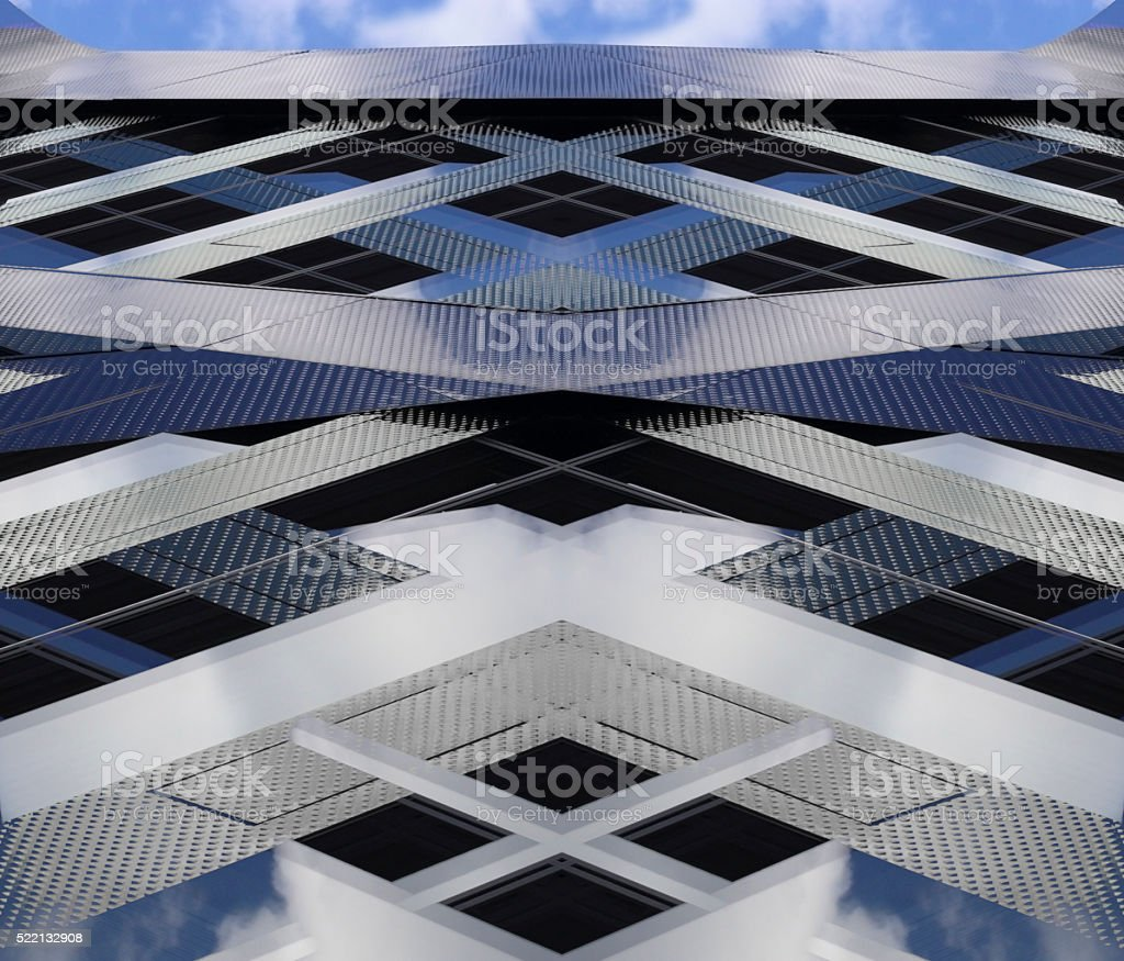 Fictional high-rise building fragment. Double-exposure photo of real architectural object stock photo