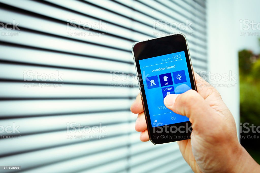 Fictive mobile app controlling the window blinds stock photo