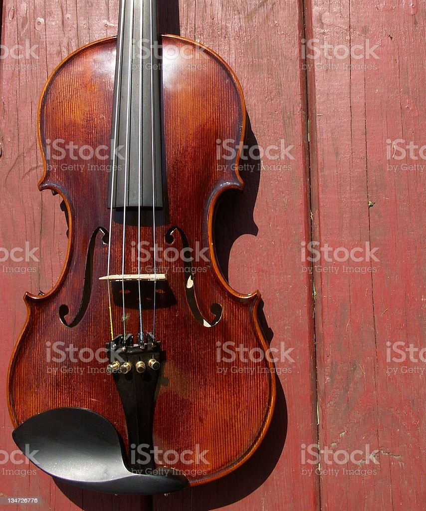 Fiddle on red boards royalty-free stock photo