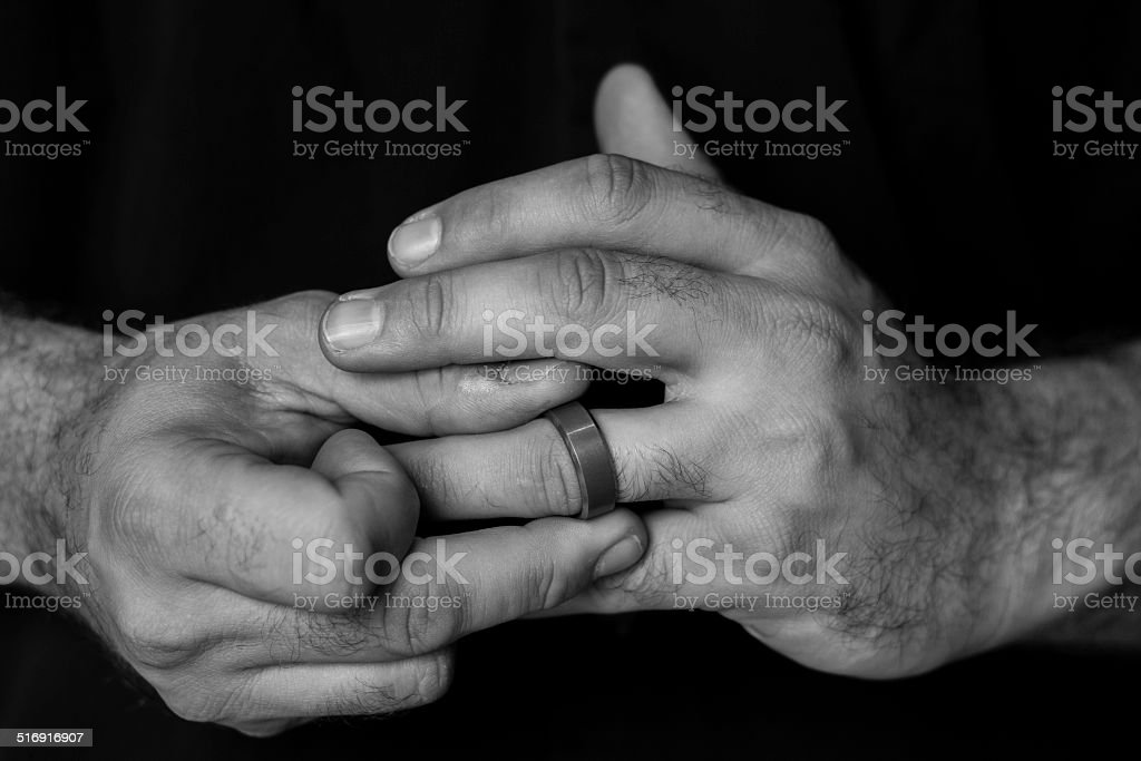 Fidgeting with Ring stock photo