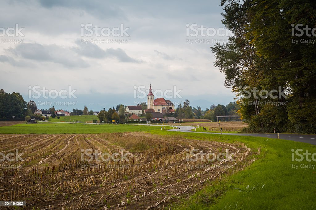 Field and church. stock photo
