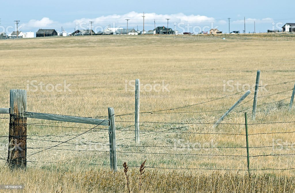 Field and town in north central Montana royalty-free stock photo